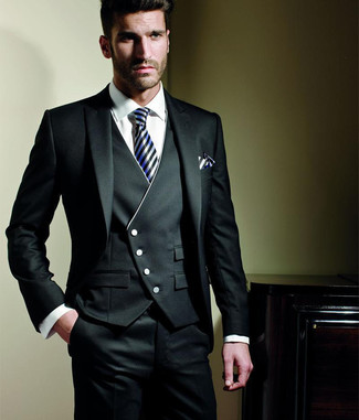 How to Wear a Black Three Piece Suit: This combination of a black three piece suit and a white dress shirt comes in handy when you need to look like a complete gent.
