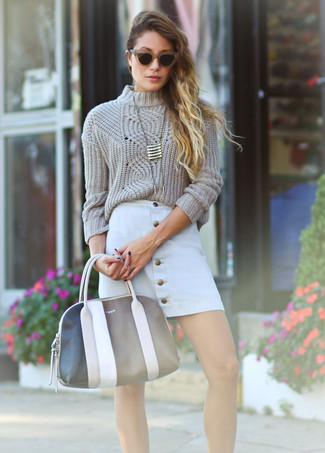 How to wear: gold pendant, black and white leather tote bag, white button skirt, beige cable sweater