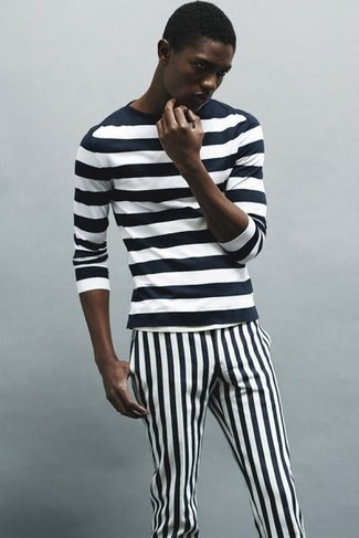 How to wear: black and white vertical striped chinos, black and white horizontal striped long sleeve t-shirt