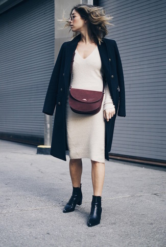 How to wear: burgundy suede crossbody bag, black leather ankle boots, beige sweater dress, black coat