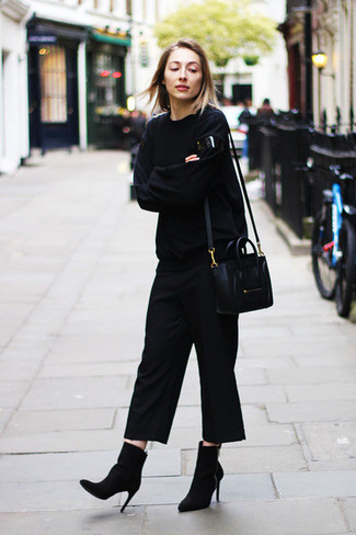 How to Wear a Black Oversized Sweater: A black oversized sweater and black culottes are the perfect base for a seriously stylish off-duty ensemble. Wondering how to round off? Add a pair of black suede ankle boots to this ensemble to step up the glamour factor.