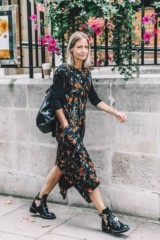 How to wear: black leather bucket bag, black cutout leather ankle boots, black long sleeve t-shirt, black floral midi dress