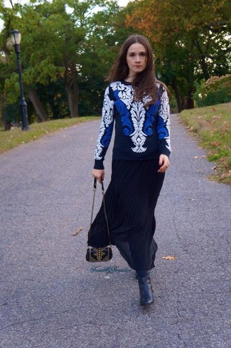How to wear: black studded leather crossbody bag, black leather ankle boots, black pleated maxi skirt, white and navy embroidered crew-neck sweater