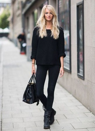 How to wear: black leather tote bag, black suede ankle boots, black skinny jeans, black oversized sweater