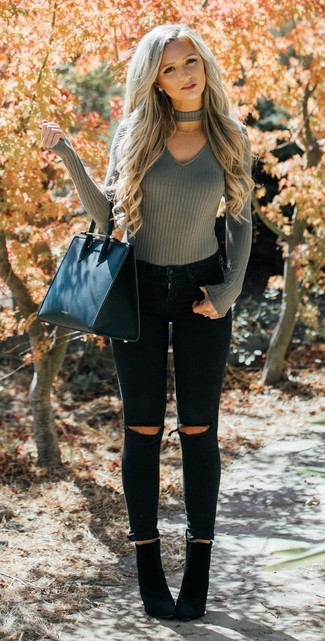 How to wear: black leather tote bag, black suede ankle boots, black ripped skinny jeans, olive v-neck sweater