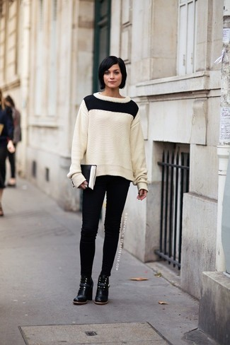 How to wear: black and white leather clutch, black leather ankle boots, black skinny jeans, white and black cable sweater