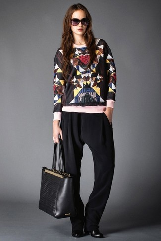 How to Wear a Black Print Crew-neck Sweater For Women: Pairing a black print crew-neck sweater with black tapered pants is a great idea for a casually cool look. And if you need to easily polish off this outfit with shoes, why not add a pair of black leather ankle boots to the mix?
