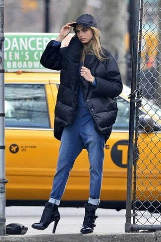 How to wear: black cap, black leather ankle boots, blue denim jumpsuit, black puffer coat