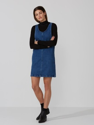 How to wear: black socks, black leather ankle boots, blue denim overall dress, black turtleneck