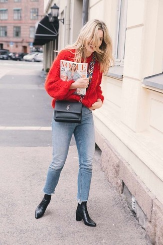 How to wear: black leather crossbody bag, black leather ankle boots, light blue skinny jeans, red knit oversized sweater