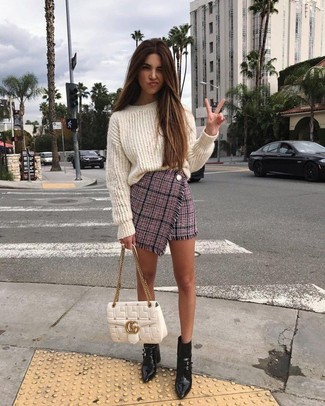 How to Wear a White Knit Oversized Sweater: This combination of a white knit oversized sweater and a pink tweed mini skirt is a safe bet for an effortlessly stylish outfit. If you want to immediately step up this outfit with one single piece, add a pair of black leather ankle boots to the equation.