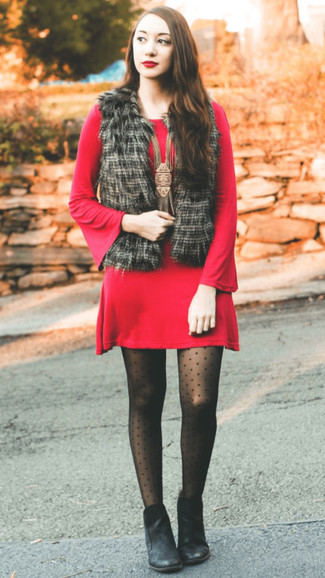 How to wear: black polka dot tights, black leather ankle boots, red sweater dress, black fur vest