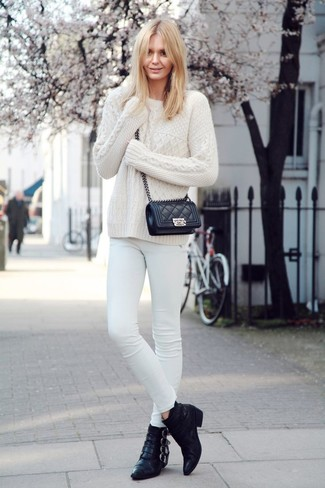 How to wear: black quilted leather crossbody bag, black leather ankle boots, white skinny jeans, white cable sweater