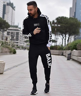 How to wear: black athletic shoes, black and white track suit
