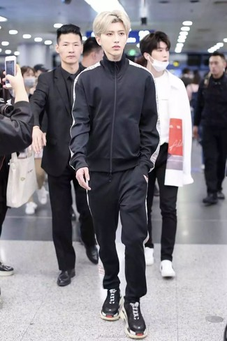 How to wear: black athletic shoes, black track suit