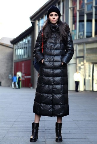 How to wear: black beanie, black leather backpack, black leather mid-calf boots, black puffer coat