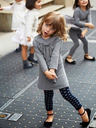 Girls' Looks & Outfits: What To Wear In 2020: Suggest that your little girl go for grey wool dress and navy polka dot leggings for an easy to wear, everyday look. This look is complemented really well with black ballet flats.