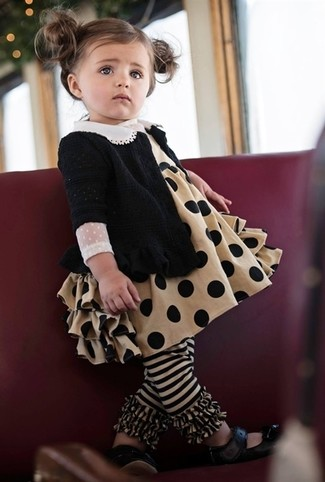 How to Wear Black Ballet Flats For Girls: Go for a black cardigan and tan dress for your little one to create a cool, stylish look. Black ballet flats are a good choice to complete this getup.