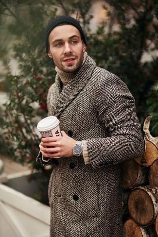 How to wear: silver watch, black beanie, beige knit turtleneck, brown herringbone overcoat