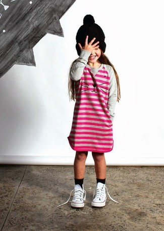 How to Wear a Black Beanie For Girls: Reach for hot pink horizontal striped dress and a black beanie for your girl for a comfy outfit. This look is complemented well with white sneakers.