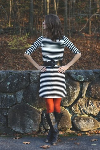 How to wear: red tights, black leather belt, black leather knee high boots, black and white horizontal striped sheath dress