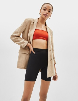 How to wear: gold earrings, black bike shorts, red cropped top, tan double breasted blazer