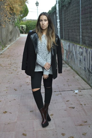 This combo of a black moto jacket and black ripped skinny jeans is a safe bet for an effortlessly cool look. Burgundy leather ankle boots will add a touch of polish to an otherwise low-key look.