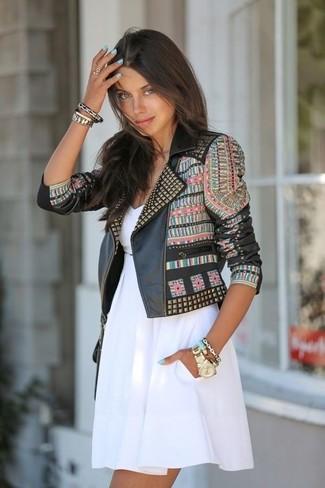 How to wear: black embellished leather biker jacket, white skater dress, gold bracelet, gold watch