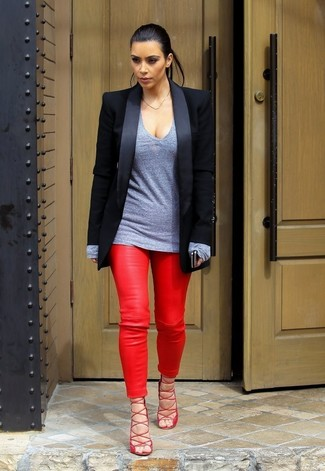 Kim Kardashian wearing Black Blazer, Grey Long Sleeve T-shirt, Red Leather Skinny Pants, Red Leather Heeled Sandals