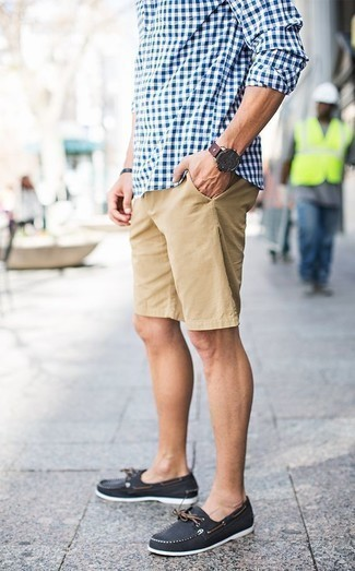How to Wear Tan Shorts For Men: Teaming a white and blue gingham long sleeve shirt with tan shorts is a nice choice for a laid-back outfit. Complement your look with a pair of black canvas boat shoes for extra fashion points.