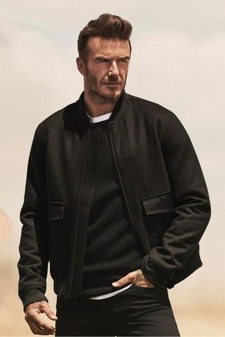 David Beckham wearing Black Wool Bomber Jacket, Black Crew-neck Sweater, White Crew-neck T-shirt, Black Jeans