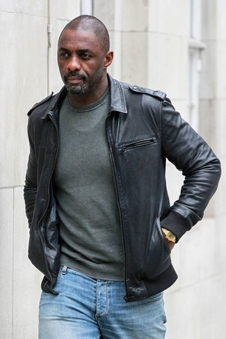Idris Elba wearing Black Leather Bomber Jacket, Dark Green Crew-neck Sweater, Light Blue Jeans, Gold Watch