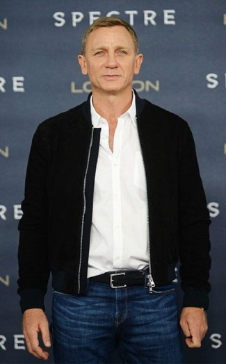 Daniel Craig wearing Black Bomber Jacket, White Long Sleeve Shirt, Blue Jeans, Black Woven Leather Belt
