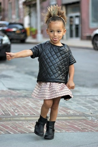 How to Wear a Black T-shirt For Girls: Help your little fashionista look fashionable by suggesting that she reach for a black t-shirt and a beige skirt. Black boots are a nice choice to round off this style.