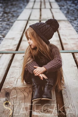 How to wear: black beanie, black boots, black leggings, brown sweater