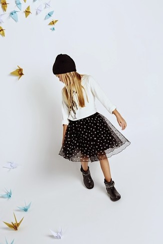 How to wear: black beanie, black boots, black tulle skirt, white sweater