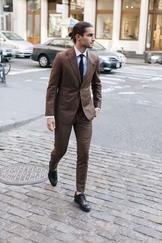 How to Wear a Brown Suit: We're loving the way this pairing of a brown suit and a white dress shirt instantly makes a man look dapper and sophisticated. You could follow the casual route on the shoe front by finishing with black leather brogues.