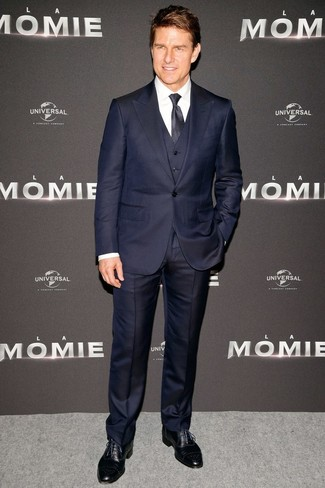 How to wear: navy polka dot tie, black leather brogues, white dress shirt, navy three piece suit