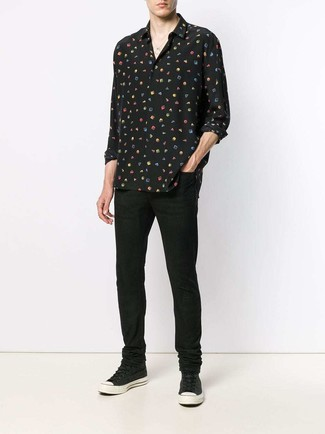 Men's Looks & Outfits: What To Wear In 2020: A black print silk long sleeve shirt and black jeans work together beautifully. A pair of black canvas high top sneakers introduces just the right amount of stylish casualness to this ensemble.
