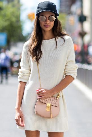 How to wear: gold sunglasses, black cap, beige leather crossbody bag, white sweater dress