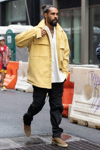 How to wear: brown suede chelsea boots, black cargo pants, white henley sweater, yellow shirt jacket