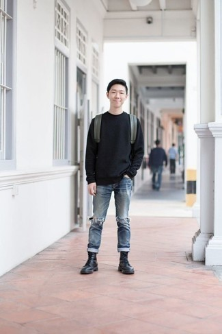 How to Wear Black Leather Casual Boots For Men: A black crew-neck sweater and blue ripped jeans are a bold casual pairing that every modern man should have in his menswear collection. You can get a bit experimental in the footwear department and elevate your outfit by rocking black leather casual boots.
