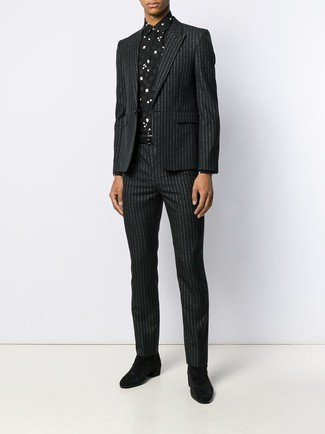 How to wear: black leather belt, black suede chelsea boots, black and white print dress shirt, black vertical striped suit