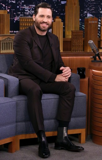 How to wear: black socks, black leather chelsea boots, black crew-neck sweater, dark brown suit