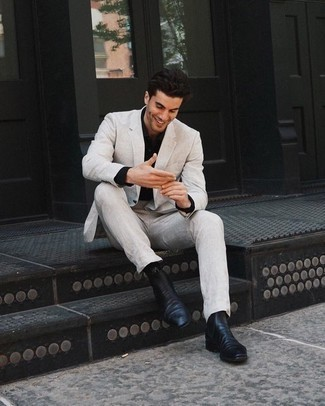 How to Wear a Black Dress Shirt For Men: No doubt, you'll look seriously dapper in a black dress shirt and a beige suit. Tone down the classiness of your look by slipping into black leather chelsea boots.