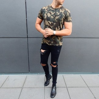 How to wear: silver watch, black leather chelsea boots, black ripped skinny jeans, olive camouflage crew-neck t-shirt