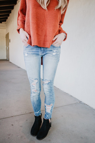 How to wear: silver watch, black suede chelsea boots, light blue ripped skinny jeans, orange oversized sweater