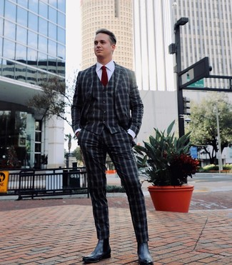 How to wear: burgundy tie, black leather chelsea boots, white dress shirt, charcoal gingham three piece suit