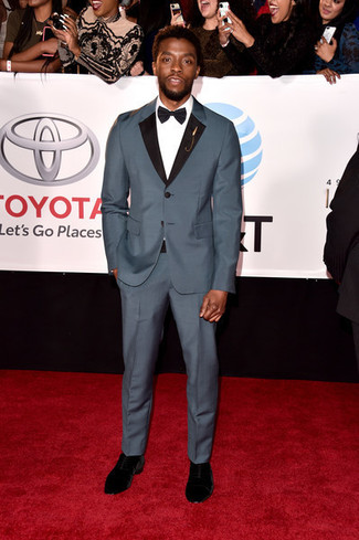 How to wear: black bow-tie, black suede chelsea boots, white dress shirt, grey suit