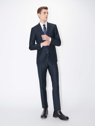 How to wear: navy print tie, black leather chelsea boots, white dress shirt, navy suit